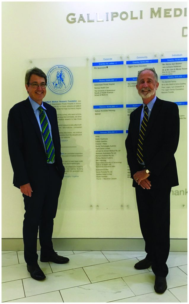 Peter Jolly and Bill Loughnan in front of the Honour Board at Greenslopes Hospital