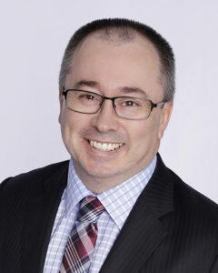 Headshot-of-Cameron-Graham-Partner