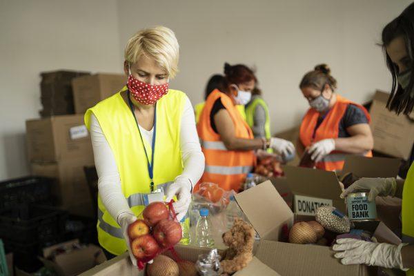 female-volunteer-packing-food