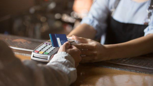 woman-paying-using-credit-card